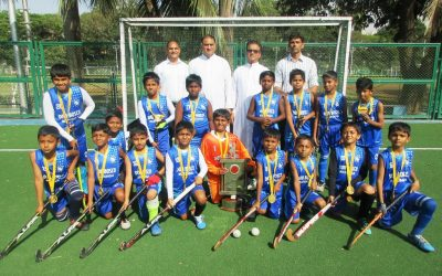 Our u-10 hockey team players return with the Oliver Andrade trophy!